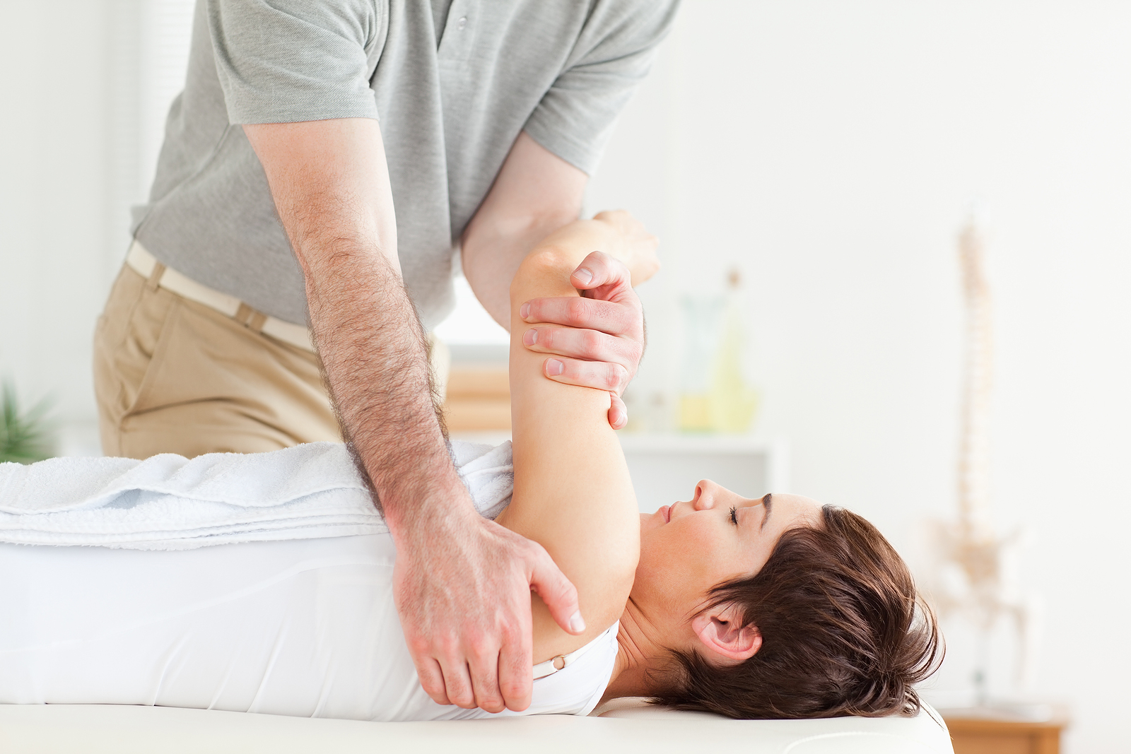 woman getting chiropractic adjustment in Long Island, NY