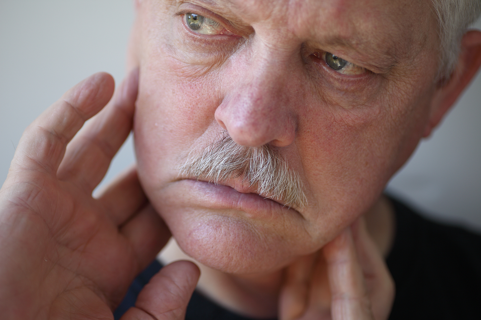 man suffering from TMJ in West Babylon, NY
